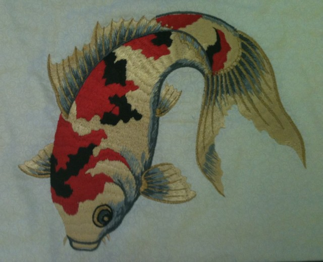 Beautifully digitized OSAWA FISH COLLECTION (available from your local Elna dealer)........Just exactly how do I get this design off the Osawa design collection CD in my computer and stitch it out at my embroidery machine?????