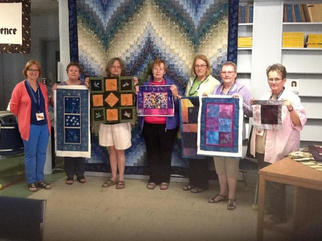 Jacqui Van Fossen of Edmonton taught a real creative & fun class on Gold; Glitter & Glam. Here her students show off the results of their labours in the 2 day class. Jacqui is far left in the pic.