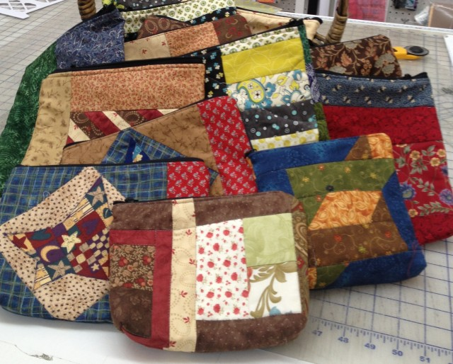Some of the bags made by Carol of HAUS OF STITCHES in Humboldt, Saskatchewan. WELL DONE CAROL!! can you beat her 20 something bags made so far??? The challenge is ON.